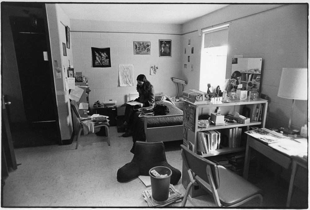 Student studying in dorm room, c.1980