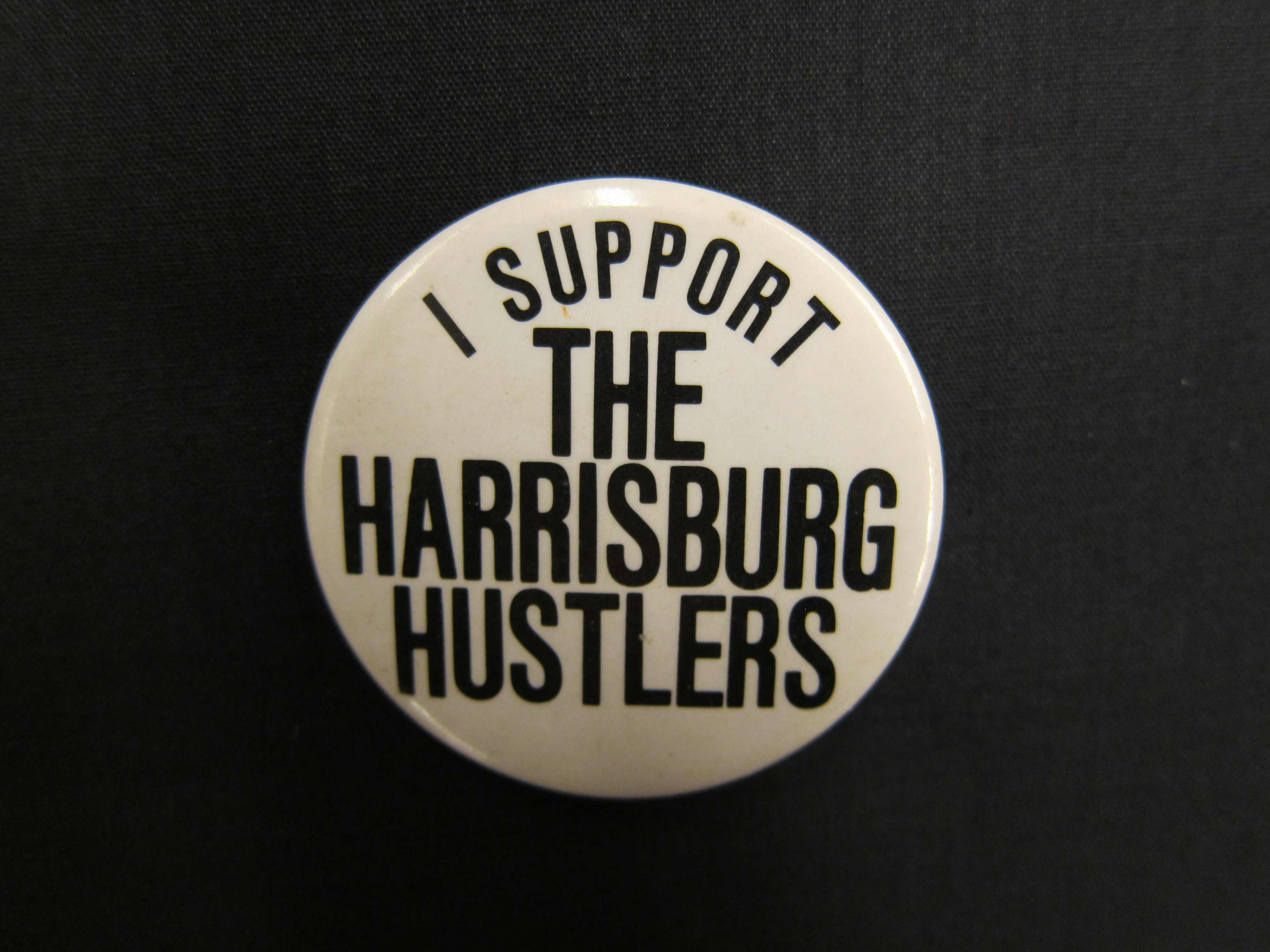 Fan button for the Harrisburg Hustlers volleyball team.