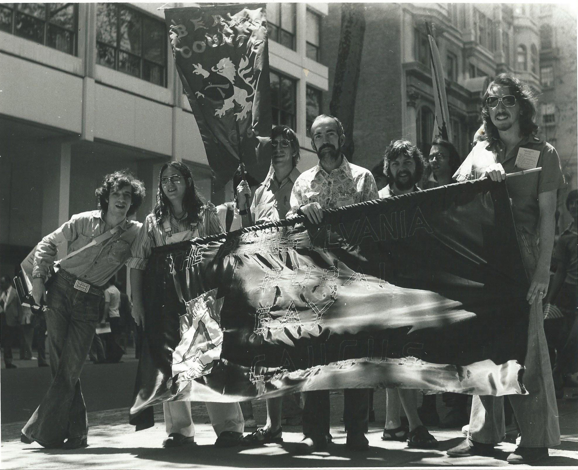 Members of the Pennsylvania Rural Gay Caucus with their hand-made banner at the Philadelphia gay pride parade circa 1976. Photo by Bari Lee Weaver.