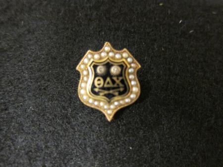 Theta Delta Chi fraternity pin, 1869