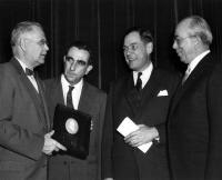 Dr. Edward Teller (second from left) receives the Priestley Award from President Edel (far left) on March 28, 1957