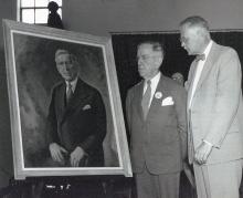 Sumner Drayer standing beside President Edel, 1957