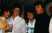 Four friends smile, c.1983