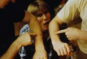 Students point to a spot on their arms, c.1983