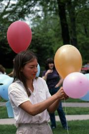 A student ties balloons together, c.1983