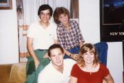 Four friends smile, c.1984