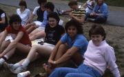 Students sit in the grass, c.1984