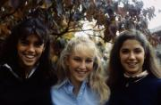Three students pose for a picture, c.1985