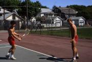 Two students play tennis, c.1985