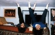 Two girls sit upside down for the camera, c.1990