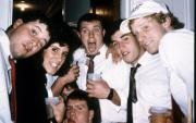 Friends pose together at a party, c.1990