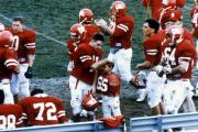 Football team gathers after a play, c.1990
