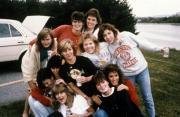 Friends pose by a lake, c.1990