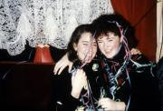 Two girls laugh with ribbon in their hair, c.1990