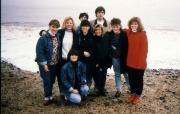 A group of students take a picture by the ocean, c.1990