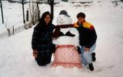 Students build snowman, c.1994