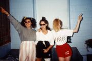 Three students show off their outfits, c.1995