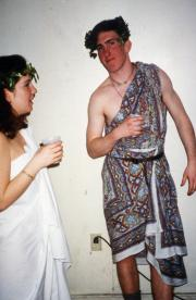 Two students in togas talk, c.1995
