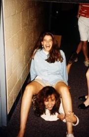 Two girls laugh in their dorm hallway, c.1995