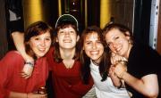 Four friends at a social event, c.1995
