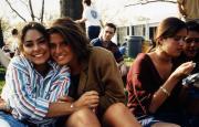 Students sit outside on Morgan field, c.1995