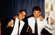 Two men in formal attire make a toast, c.1995