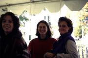 Three students stand under a tent, c.1996