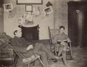 Two students in rocking chairs, c.1900