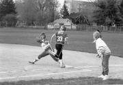Softball player runs to the base, 1989