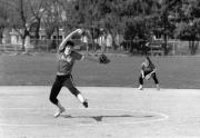 Softball player pitches, 1989