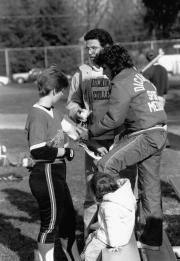 Softball player receives first aid, 1989