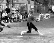 Softball player swings, c.1990
