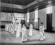 Women's physical education class with poles, 1888