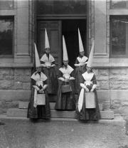 Female students in dunce caps, c.1890