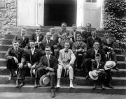 Alumni seated on the steps of West College