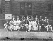 Alumni from the Class of 1900 holding pennants, 1915