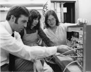 Physics professors and student with science equipment, 1979