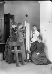 Female students performing science experiment, 1889