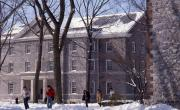 Students walking through the academic quad in the snow, 1988