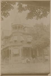 Group in front of house, c.1895
