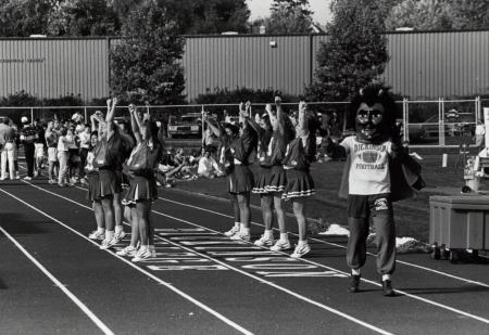 Cheerleaders and Red Devil at Homecoming, 1992